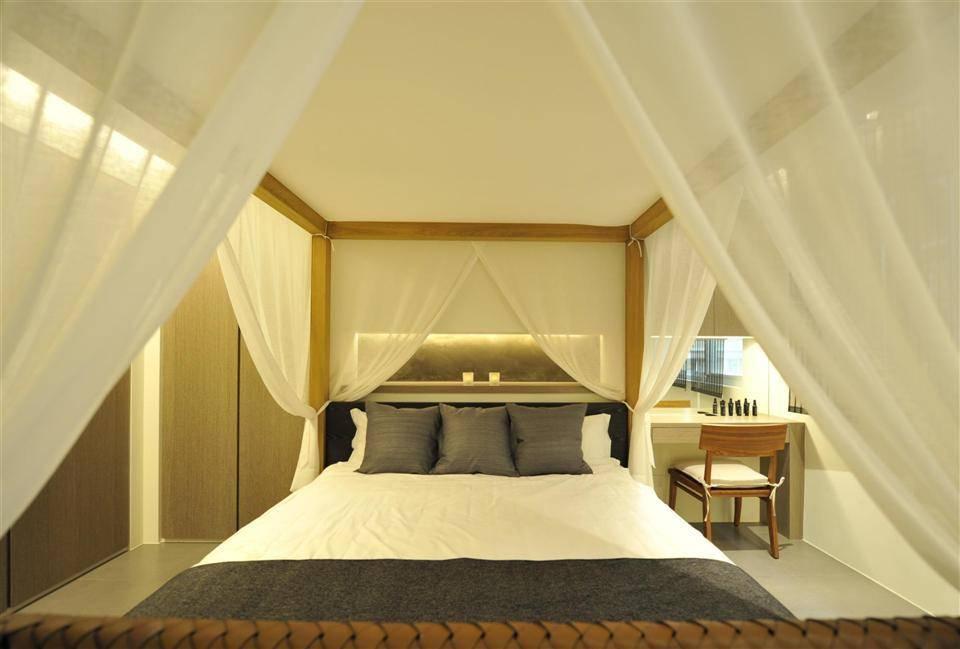 簡中式臥室大床效果圖