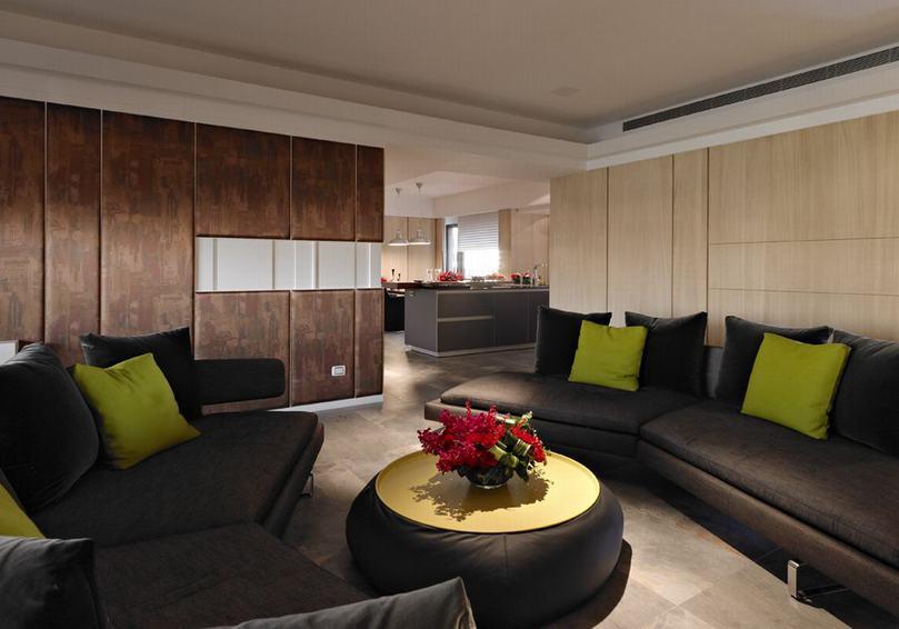 沉穩現代客廳黑色沙發裝飾圖