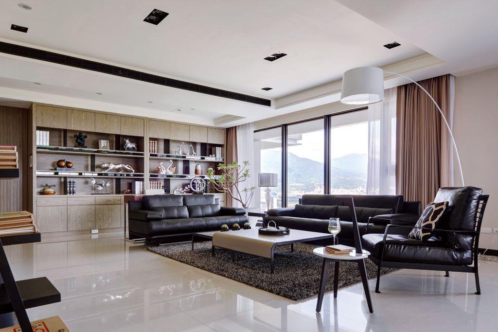 現代公寓客廳黑色家具裝飾圖